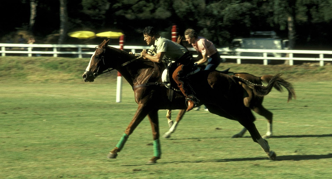 Sylvester Stallone on horseback during a horse race