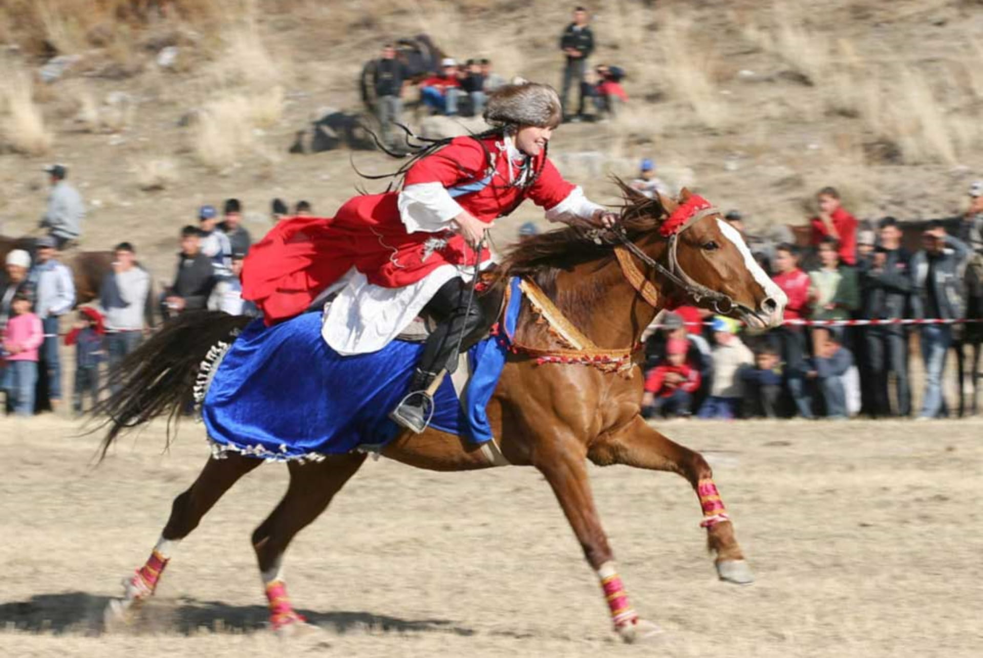 Kyz kuumai, or Kyz koo, is an equestrian game among the Turkic people, such as the Azerbaijanis, Kazakhs and Kyrgyz.