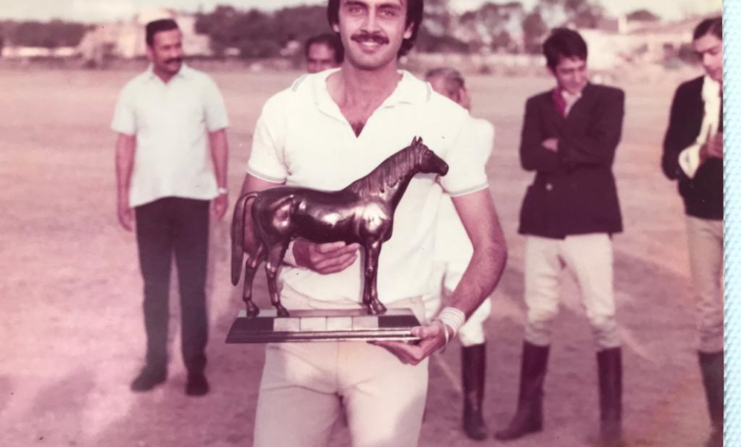 polo-player-holding-trophy